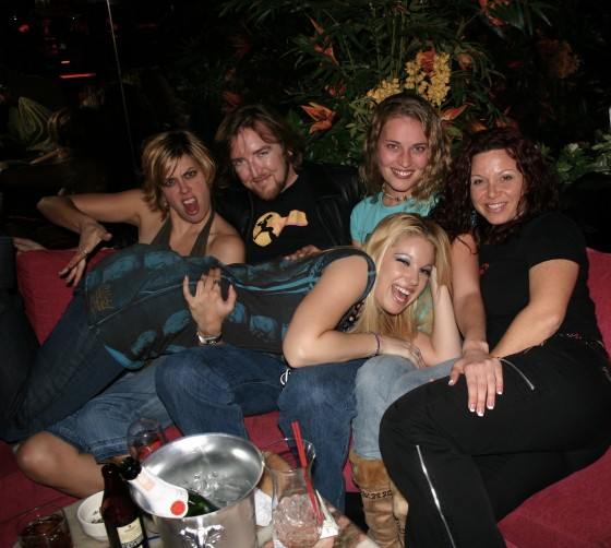 Cat P., some clown, Daisy Layne, and [unidentified] prop up Hollie Stevens on her birthday, 2006